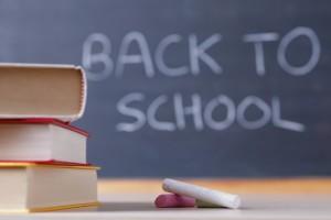 """Blackboard with """"back to school"""" written on it."""